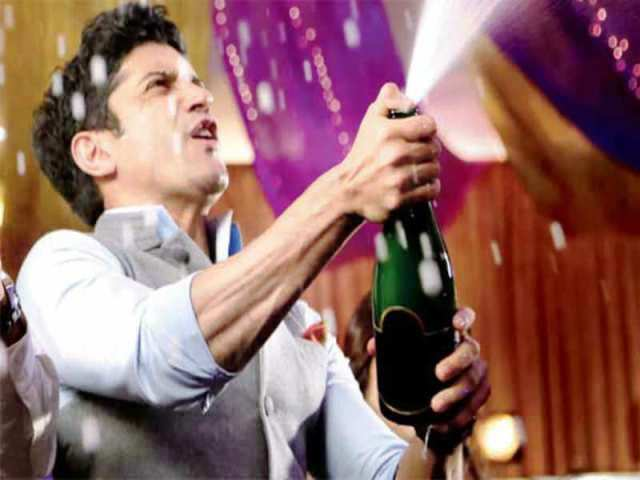 Farhan Akhtar with a bottle of alcohol