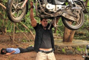 John Abraham Lifting A Bike In Force