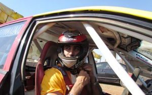 Kunal Kapoor in a ralley racing car