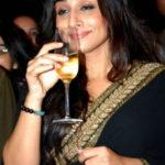 Vidya Balan drinking