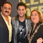 Aadar Jain with his parents