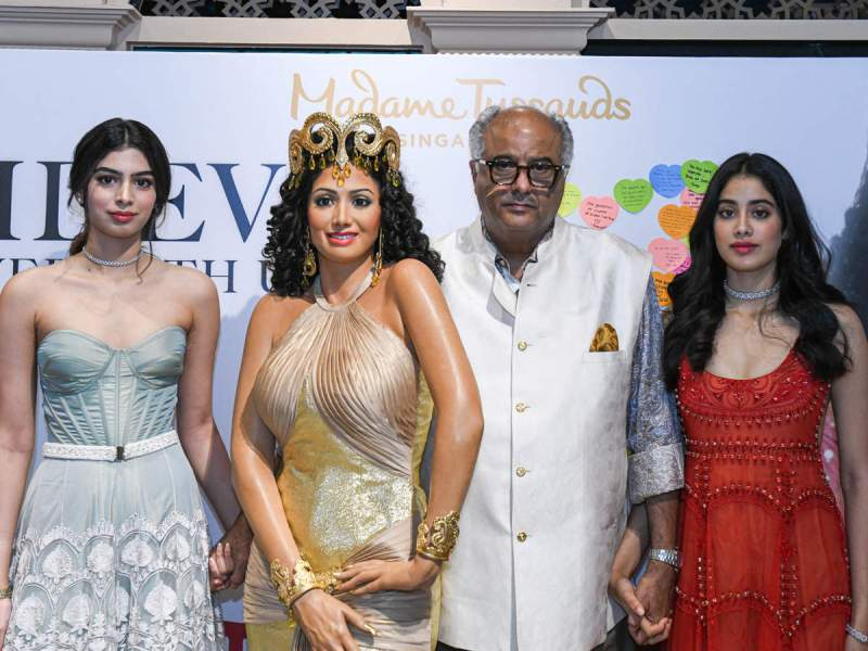Janhvi, Khushi, and Boney Kapoor with a wax figurine of Sridevi at Madame Tussauds Singapore