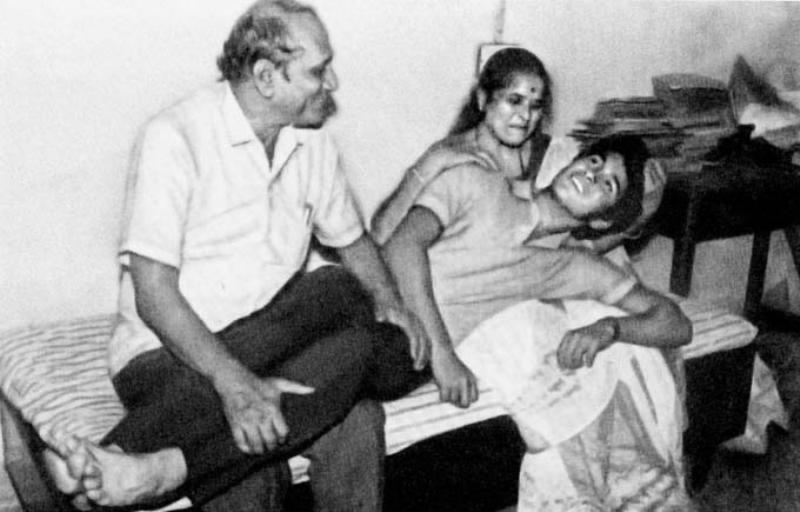 Sachin Tendulkar Lying in The Lap of His Parents