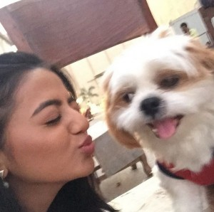 Helly Shah playing with dog