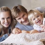 Shane Watson with his wife and children