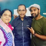 Bosco Martis with his parents