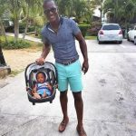 Darren Sammy with his son