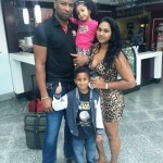 Kieron Pollard with his wife and children