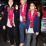 Neel Sethi with his parents