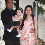 Sakshi Dhoni with MS Dhoni and their daughter