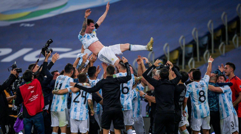 Lionel Messi is lifted by his Argentina teammates at the end of the Copa America final on 11 July 2021