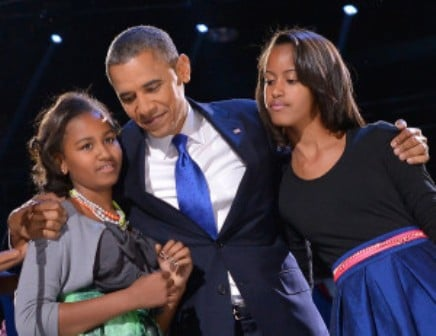 Obama with his daughters Malia and Natasha