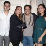 Govinda with his wife and children