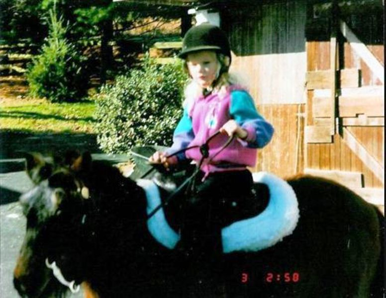 Childhood Picture of Taylor Swift Riding on Her Horse