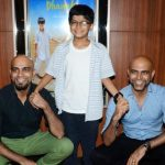 Rajiv Laxman with his son and brother