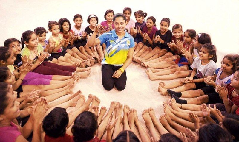 Dipa Karmakar Sitting Among The Young Girls Of Her Hometown Tripura