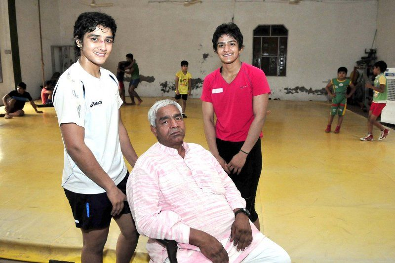 Geeta and Babita with their father Mahavir Singh Phogat
