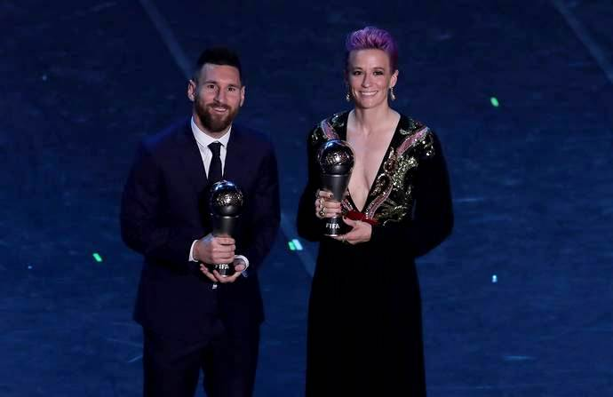 Megan Rapinoe with Lionel Messi