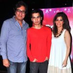 Talat Aziz with his wife and son