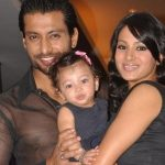 Barkha Bisht with her husband and daughter