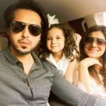 Fahad Mustafa with his wife and daughter