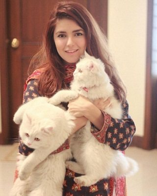 Momina with her pet cats