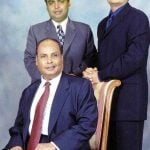 Mukesh Ambani with his father Dhirubhai Ambani (sitting) and brother Anil Ambani (right)