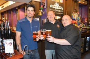 Alastair Cook (left) drinking beer