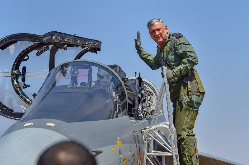 Bipin Rawat waving while going to fly LCA Tejas