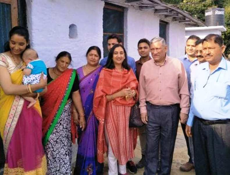 Bipin Rawat with his family members in his native village in Uttarakhand