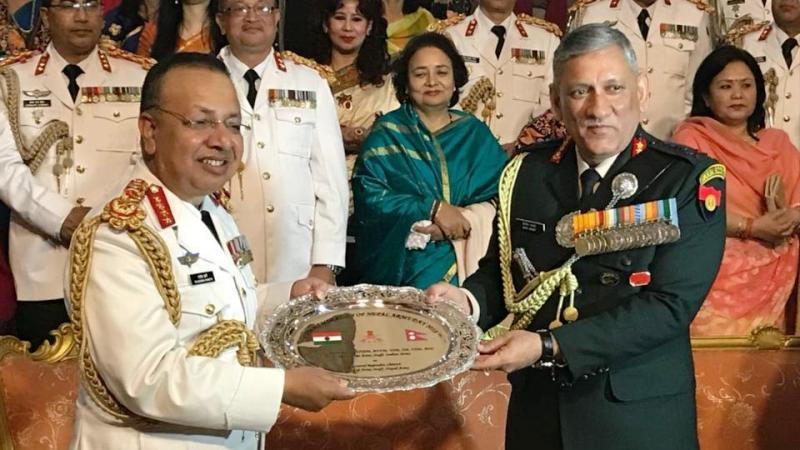 General Bipin Rawat presents a memento to General Rajendra Chhetri, Chief of the Army Staff Nepal Army, on the occasion of Nepal Army Day 2018