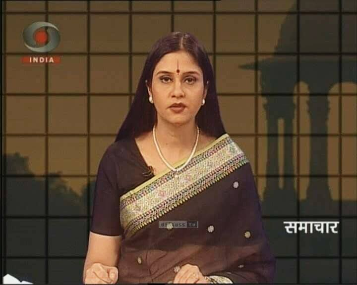 Neelam Sharma, anchoring a news show on DD INDIA