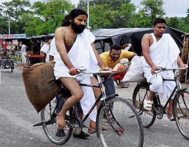 Acharya Balkrishna and Baba Ramdev while selling products on cycle