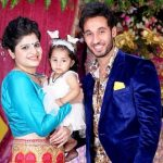 Gaurav Ajay Kaura with his wife and daughter