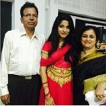 Neethusha Cherckal with her parents