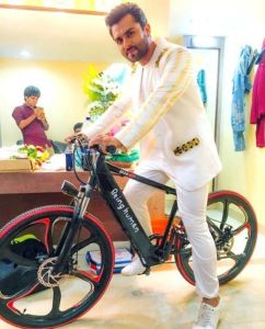 Shoaib Ibrahim poses with his Being Human cycle