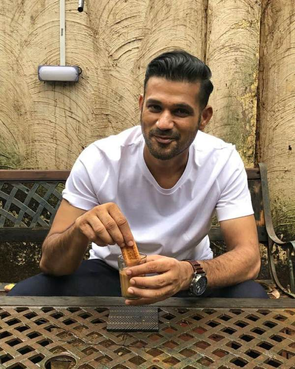 Soham Shah Dipping Parle G Biscuit in a Glass of Tea