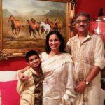 Supriya Vinod with her husband and son
