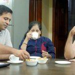 Nisha Madhulika with her Husband (right) & Son (left)