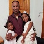 Samuel Badree with his daughers