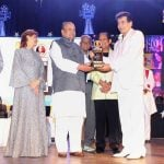 Jeetendra receiving Dada Saheb Falke Award