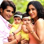 Teejay Sidhu with her husband and  twin daughters