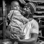 Kofi Kingston with his elder son