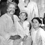 The Kapoor Family - Raj Kapoor and Shammi Kapoor (standing); Prithviraj Kapoor with Randhir Kapoor on his lap and Shashi Kapoor (sitting)