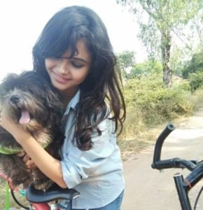 Muskan Bamne with her pet dog