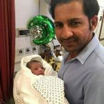 Sarfraz Ahmed with his son