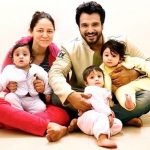 Vinay Anand with his wife and children