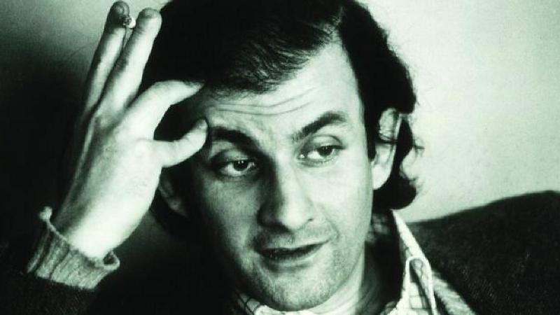 An old picture of Salman Rushdie while holding a cigarette