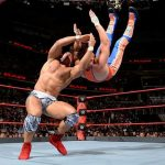 Jason Jordan back to belly neck breaker finisher