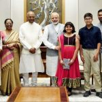 Ram Nath Kovind with his family and Narendra Modi
